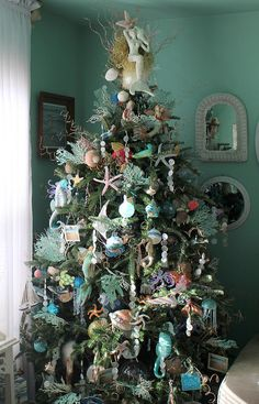 Under the Sea Christmas Tree & oh my.look at that mermaid angel tree topper! Beach Christmas Trees, Coastal Christmas Decor, Nautical Christmas, Christmas Tree Themes, Noel Christmas, Holiday Tree, Christmas Tree Toppers, Xmas Tree, Xmas Decorations