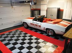 Black and white snap together garage flooring tiles with red border | Flooring Ideas | Floor Design Trends
