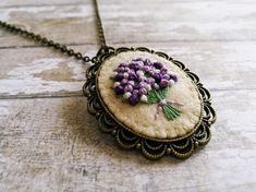 Lilac Embroidered Bouquet Pendant Necklace / Floral Flower Embroidery Jewelry / wool felt bronze brass antique style necklace / Mothers day gift  This listing is for 1 necklace with embroidered pendant  Vintage style handmade embroidered jewelry. Basic fabric is wool felt. Pendant: Finding