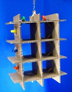 could make this with the insert from a wine shipping box (free from your local liquor store), some leather cording and beads Cockatiel Toys, Parakeet Toys, Budgies, Parrots, Diy Parrot Toys, Diy Bird Toys, Homemade Bird Toys, Rat Toys, Bird Stand