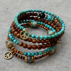 Boho chic - Amazonite, Tiger's eye, howlite, African trade beads, Turquoise, Onyx, and wood beaded bangle yoga jewelry. $98.00, via Etsy.