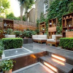 Amazing landscape lighting in this backyard space.  It's amazing what lighting does to accentuate a small space.