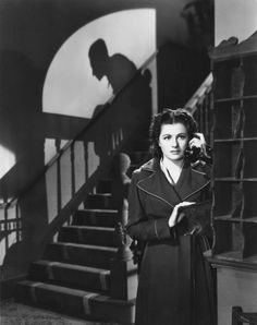Night Train to Munich (Carol Reed, 1940) - Danger lurks in silhouette behind Margaret Lockwood as she makes a telephone call in Carol Reed's espionage thriller – a film which was initially marketed as a sequel of sorts to Alfred Hitchcock's The Lady Vanishes (1938).