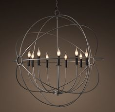 """RH's Foucault's Orb Chandelier 41"""":Nineteenth century experimental physicist Léon Foucault's gyroscope inspired our openwork globe. Its double-gimbal frame is built of iron around a nucleus of upraised lights, an homage to Foucault's study of the earth's rotation."""