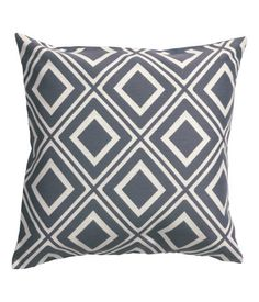 Cushion cover with a jacquard-weave pattern at front and solid color at back. Concealed zip.