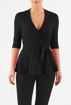Our cotton jersey knit wrap top is styled with a low surplice V-neck and a rounded peplum hem for a modern update on a classic.