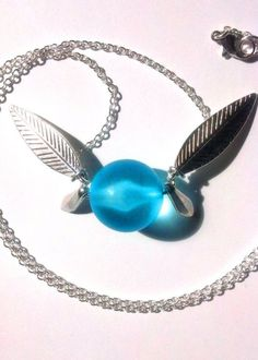 Legend of Zelda Navi-inspired fairy necklace. Please can I have it!?
