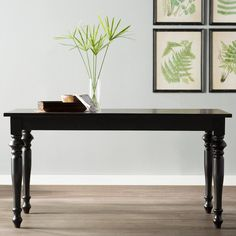 All wood rectangular dining table is a wonderful addition to any home. The natural grain of the wood comes through in the curves and finish of this table. A versatile table that can be dressed up for formal dining or kept casual for breakfast. Pair with your favorite dining chairs. The top features an oak veneer with engineered hard and soft woods and is accented with carved elm solid wood legs. Seats 6 comfortably. Great for small space living. Takes less than 30 minutes to assemble.
