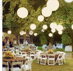 Could anything be more perfect? Wedding outside with lanterns, burlap tablecloths and sunflowers.