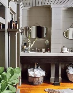 This bathroom is spectacular. Love the contrast of the bright wood flooring and the light gray siding and ceiling.