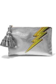 The 'Georgina' clutch is one of Anya Hindmarch's signature accessories, recognizable by its oversized handcrafted tassel charm. This version is made from high-shine silver textured-leather and playfully embossed with a lightning bolt. Use the internal card slots and zipped pocket to organize your essentials.