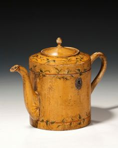 Rare teapot tea caddy //  An extremely rare tea caddy in the form of a teapot, the fruitwood carcass painted and decorated with trailing vines and gilt highlights possibly continental.  // Price  GBP 12500 (Pound Sterling) //  - Maria Elena Garcia -  ► www.pinterest.com/megardel/ ◀︎