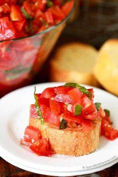 Fresh tomato Bruschetta on a peice of garlic toast.