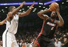Miami Heat's LeBron James (6) shoots over Brooklyn Nets' Joe Johnson (7) during the second half of an NBA basketball game Thursday, Oct. 17, 2013 in New York. The Nets won the game 86-62. (AP Photo/Frank Franklin II)