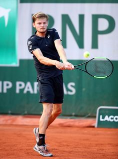 David Goffin Photos - David Goffin of Belgium plays a backhand during the mens singles first round match against Robin Haase of Netherlands during day one of the 2018 French Open at Roland Garros on May 2018 in Paris, France. - 2018 French Open - Day One David Goffin, Pro Tennis, French Open, Tennis Players, Wedding Humor, Figure Skating, Tennis Racket, Snowboarding, Two By Two