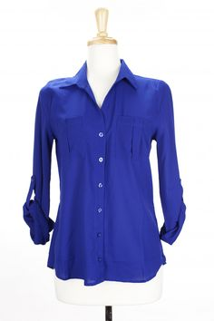 "Dressing Your Truth - Type 4 Royal Blue Button Down Top     This deep royal blue colored top is crafted of a lightly textured crepe. Wear the sleeves long or rolled and fastened with the button-up tabs.        100% Polyester      Long Sleeve      Button Front      26"" length from top of shoulder (measurement taken from size small)"