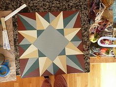"""smaller size quilt block on wood similar to """"barn Quilts""""e,  Need this on the outside of my house."""