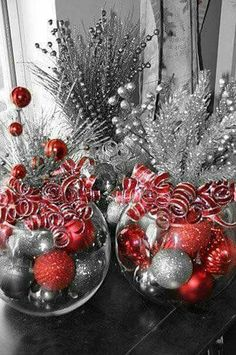 Christmas centerpiece-glass globe filled with ornaments, stems out of top and ribbons. Do with gold instead of silver.