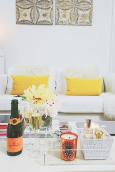 New York City Studio Apartment Tour. Candles and pillows add a pop of colour to any room
