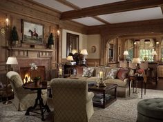 Living Room/Library -- Scott Snyder Inc. -- North Shore, New York home project -- Fireplace, wainscoting, ceiling beams