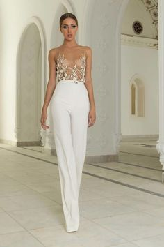Modern and extra glamorous white jumpsuit, perfect for a daring bride.