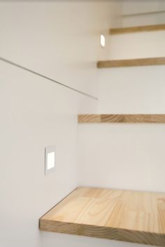 A close-up picture of the stair lights in the tiny house.