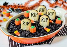 """Graveyard Chocolate Cheesecake Dip - A dessert dip that tastes like a decadent chocolate cheesecake. Topped with crunchy chocolate cookie """"dirt"""" and vanilla cookie """"tombstones,"""" this easy recipe is the perfect Halloween treat."""