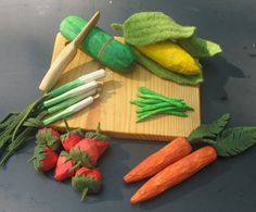 hand carved play fruits and veggies.  supposed to be easy with tutorial at duo fiberworks.