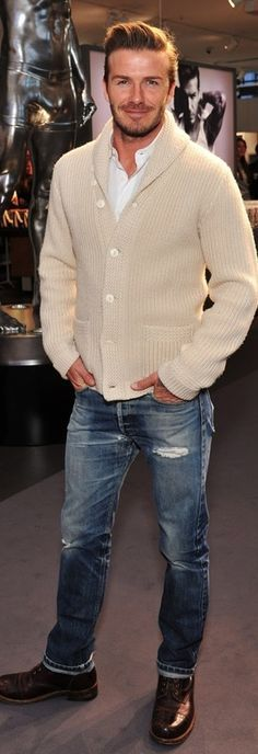 David Beckham, Winter White Cashmere Shawl Collared Cardigan, Distressed Fitted Jeans, and Cognac Laceup Brouge Style Boots. Men's Fall Winter Fashion.
