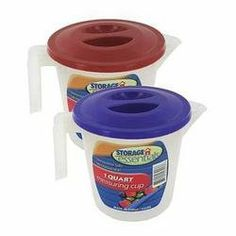 """Measuring Cup With Lid by storage essentials. $65.11. Measuring cup with lid is ideal for food preps such as sauces, cheeses, broths, gravy and more. Also helps prevent spills and splashes. Cups are transparent with markings on two sides measuring both CC (up to 900) and ounces (up to 32). Lids are detachable and come varying colors including blue or red. Microwaveable and dishwasher safe. Comes packaged loose with an artwork label. Stands 4 3/4"""" tall."""