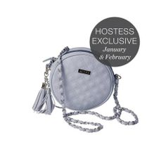 """Mariah Hip Bag: The unique round shape of the Mariah Hip Bag offers a sassy retro look combined with modern styling to create the ideal take-anywhere accessory for the woman on the go. Powder-blue quilted faux leather features two chic tassel accents & an irresistible matching long strap with a woven silver chain. Interior is lined with cream, blue and green floral print fabric. Top zipper closure. Dimensions: 6 ½"""" diameter with a 2"""" gusset; handle is 3/8"""" wide with a 21 ½"""" handle drop."""