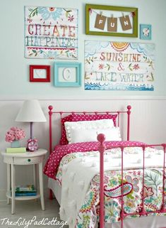 Love the F-U-N banner and the brightly painted bed. Could do child's name instead. Sheets match bed color, with lighter linens on top, other furniture is white. White and pale blue on wall. Very well done.