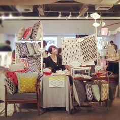 renegade craft fair table selling handmade pillows and tea towels