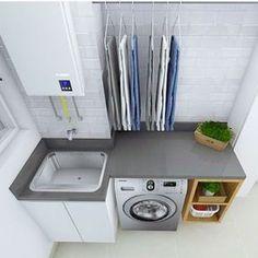 lavanderia pequena com bancada cinza, maquina lava e seca e nichos