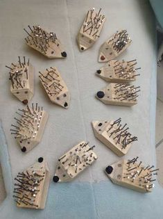 children create hedgehogs with wood and nails.