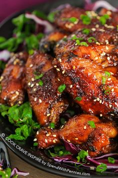 This Sticky Hot Wings recipe has just the right amount of sticky sweet heat and big flavor. Plus a secret tip to make sure your oven baked chicken wings are extra crispy!