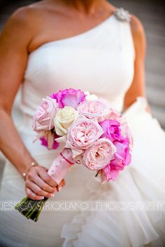 This bride used a striking and bold shade of pink. The colors were beautiful in her bouquet. Floral Design by McNamara Florist - Enflora.