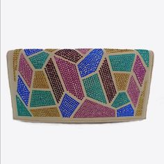 Beige Clutch W Colorful Rhinestones 11 x 6.25  Flap closes with 2 snaps. inside closes with zipper and additional side zipper pocket. Silky gold inside . Includes chain. Bags