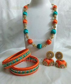 Orange and Green Silk Thread Jewellery Set Tired of metal jewellery? Try out our colorful, unique and customized silk thread jewellery! Silk Thread Bangles Design, Silk Thread Necklace, Thread Jewellery, Metal Jewellery, Handmade Jewellery, Antique Jewelry, Gold Bar Earrings, Gold Earrings Designs, Jewelry Sets