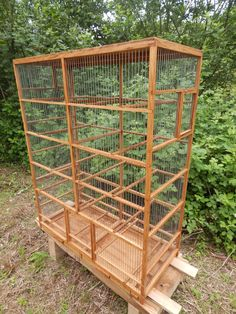 Brand new, unused, handmade wooden bird cage, cage is made from oak, wire spacing is about 0,4 inch and is painted with linseed oil, 12 movable rungs