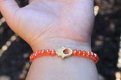 A personal favorite from my Etsy shop https://www.etsy.com/listing/473888382/orange-and-gold-hamsa-hand-beaded