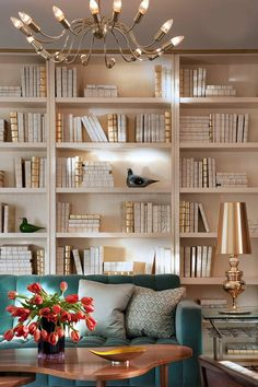 This home office allows the bold teal sofa to take center stage with a backdrop of all-neutral books and tchotchkes filling its built-in shelves. Top Interior Designers, Best Interior Design, Interior Design Services, Interior Design Inspiration, Design Ideas, Luxury Interior, Room Inspiration, Design Trends, Zoom Wallpaper