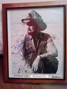 This 1982 autographed 8 x 10 photograph of Johnny Lee, an icon of country music, shows the Gilley's Pasadena, TX logo and lists Sherwood Cryer as his personal manager. It is now part of the GilleysMuseum.com collection of Gilley's and Urban Cowboy memorabilia.