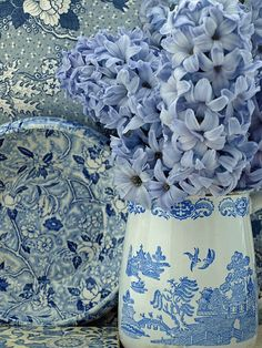 blue and white pottery and flowers