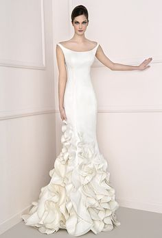 Brides: Antonio Riva. Off-the-shoulder triple organza wedding dress with asymmetrical cascading ruffles along the skirt.