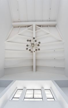 Exposed ceiling trusses in double story gallery