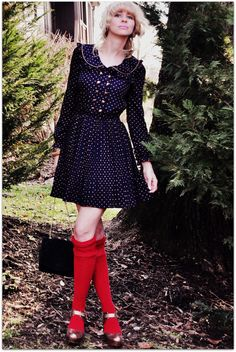 vibrant knee socks, metallic mary janes, and a polka-dotted, peter pan collar, long-sleeved dress.