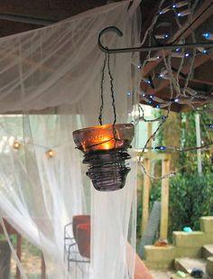 Glass insulator hanging luminaria.