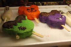 Halloween Treats at Disney World. Why not make the basic Mickey shaped Rice Krispy treats and then provide all the extras and let guests decorate them!