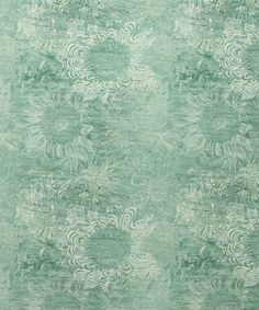 Rose May Linen Union in Jade from the Nesfield collection by Liberty furnishing fabrics.  Inspired by the planting of sunflowers annually on 1st May by guerrilla gardeners, the hand drawn sunflowers were scraped out from wax crayon to create a large, textural tonal floral. The printing process allows this detail to be realised, almost as if the fabric itself has been painted #LibertyPrint